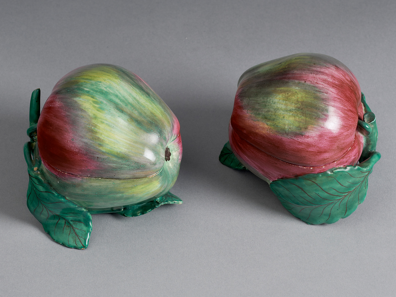 An Extremely Rare Pair of Strasbourg Faience Apple Boxes and Covers