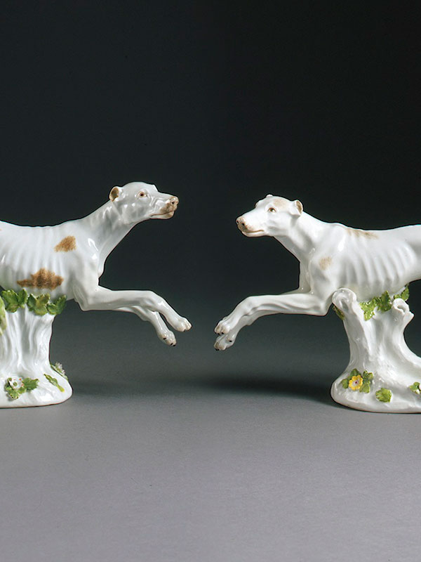 Pair of Meissen models of running Greyhounds, modelled by J.J.Kaendler