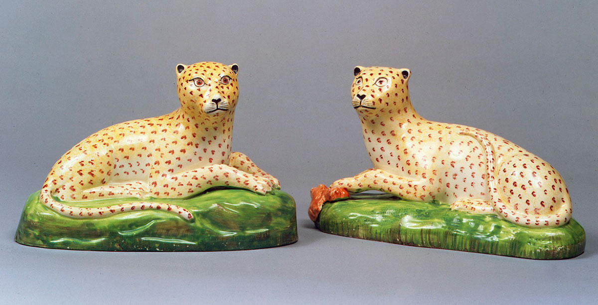 Pair of Staffordshire Creamware models of reclining Leopards circa 1800